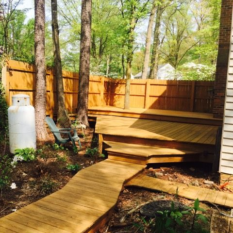 Residential patio after Reyco wood cleaning and sealing.
